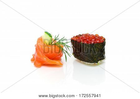 Gunkan with red caviar and roll with cucumber on a white background. horizontal photo.