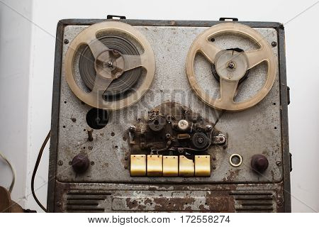 Old retro film recorder. Musical instrument on a gray background.