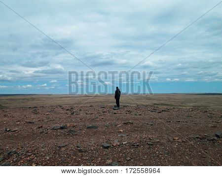 lonely traveler on the plateau, travel concept