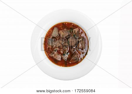 fried liver heart in tomato sauce kaurma  traditional Georgian dish white background top view