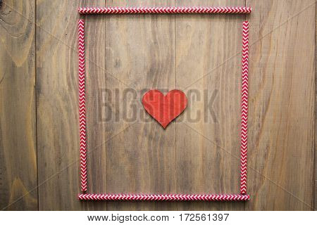 mock up background with cocktail straws and a heart on wooden background