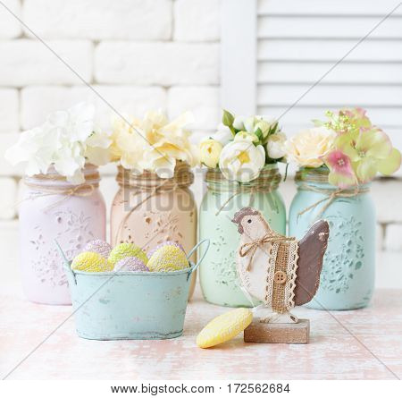 Beautiful flowers in mason jars and shabby chic decoration.