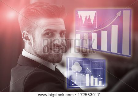 Graph against handsome businessman smiling