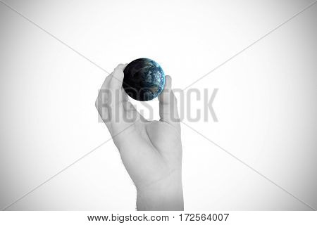 Hand showing against earth over white background