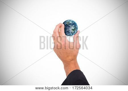Hand presenting against globe of earth