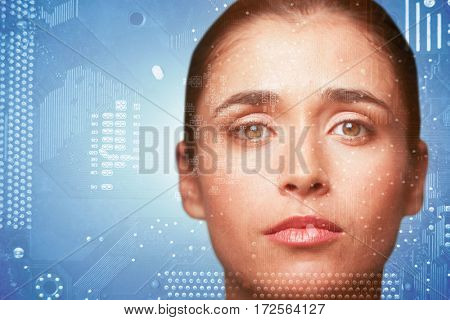 Portrait of woman with brown eyes against micro parts of mother board