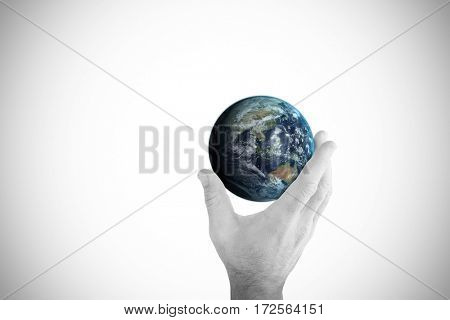 Hand presenting against image of earth