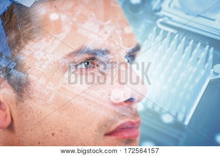 Close-up of man wearing contact lens against micro parts of mother board