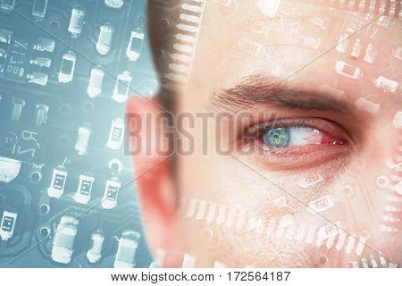 Man with blue eyes looking away against globe in circuit board