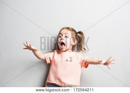 Little cute girl screaming or scearing surprized