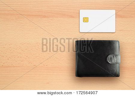 Credit card and wallet on desk top view
