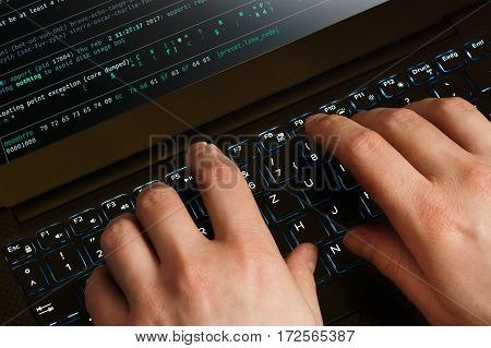 Hacker hands, first person view, at work on a code.