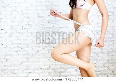 Young Giirl Posing Fitness With Measurement Tape Around Her Butt - Butt Fitness And Body Beauty Conc