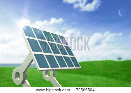 Solar panel with stand against green field under blue sky