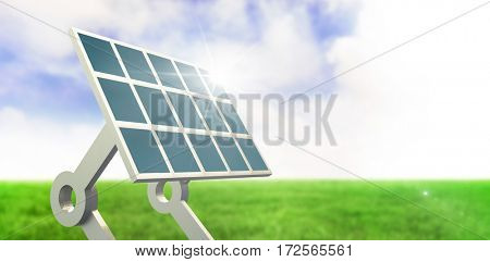 Solar panel with stand against blue sky over green field