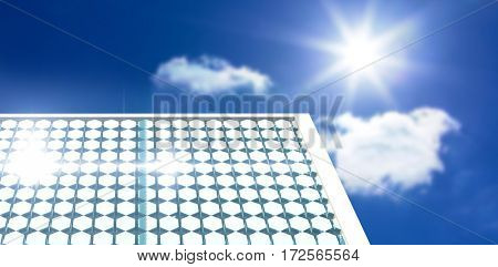 Solar panel with hexagon shape glasses against bright blue sky with clouds