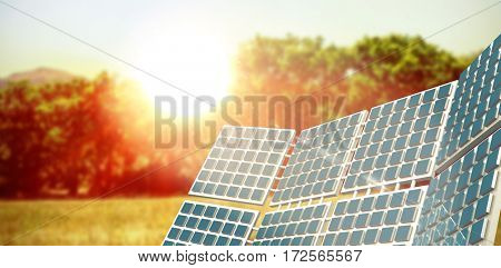 Three dimensional of solar power against sun rise over trees