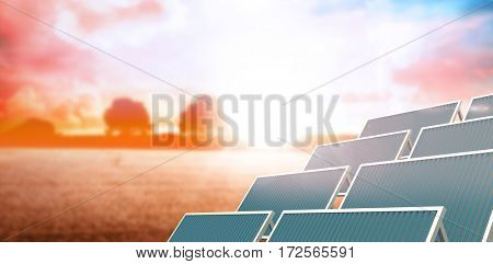 Vector image of solar panel against white screen against countryside scene