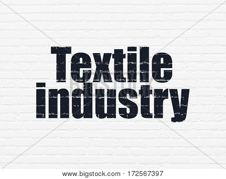 Manufacuring concept: Painted black text Textile Industry on White Brick wall background