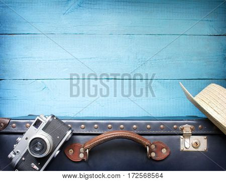 Old retro vintage suitcase and camera tourism travel background concept
