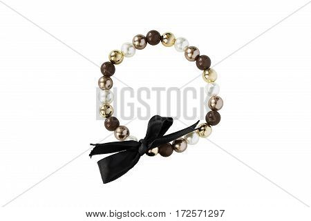 Bracelet with pearl and beads and black bow isolated over white