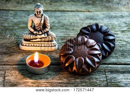 natural chocolate mandala handmade near the Buddha statues