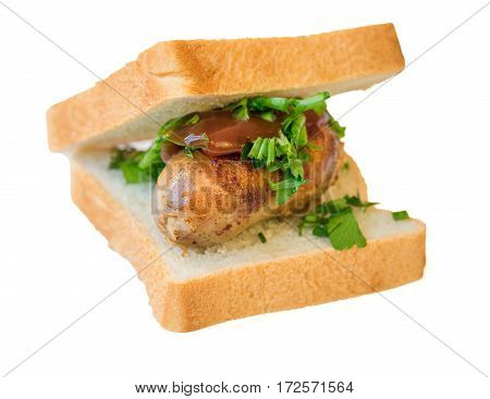 Home sausage with bread isolated on white background. Sandwich with sausage onion and parsley.