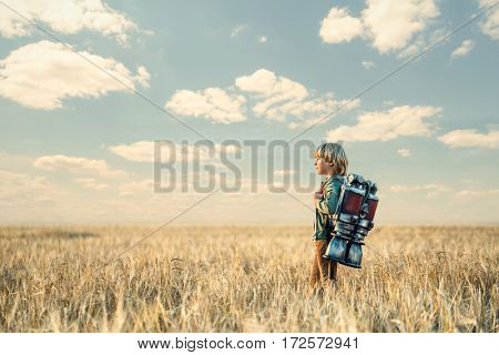 Boy with a backpack outdoors