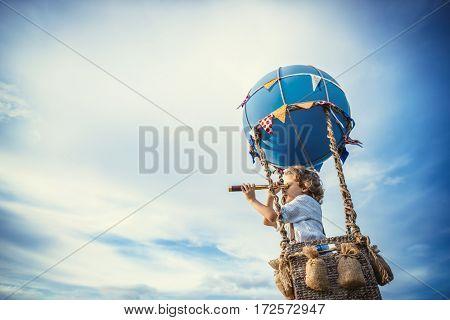Little boy traveling in a balloon