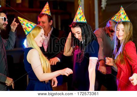 Young peoples birthday party in the nightclub. Dancing on the dancefloor