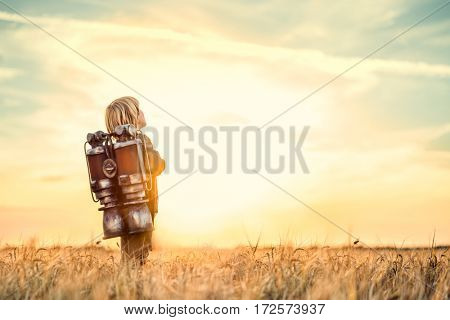 Dreaming child in a wheat field
