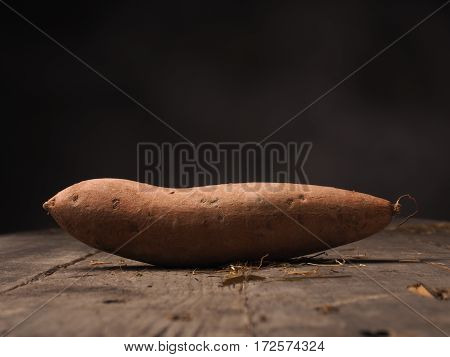Fresh batata on an old rustic wooden table