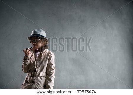 Smoking boy in studio