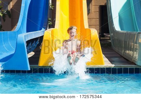 Boy has a good time in aquapark in the summer