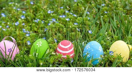 Colorful Easter Egg In The Fresh Spring Meadow