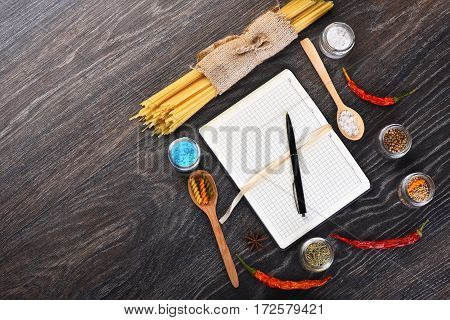 Open Notebook With Pen And Colorful Italian Pasta
