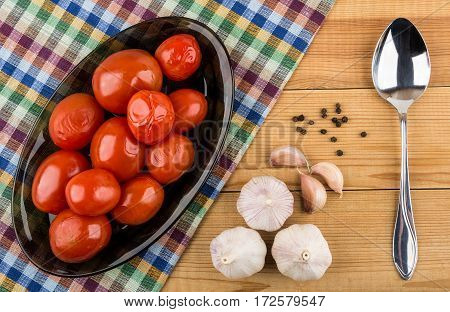 Dish With Red Marinated Tomatoes, Garlic, Black Pepper And Spoon