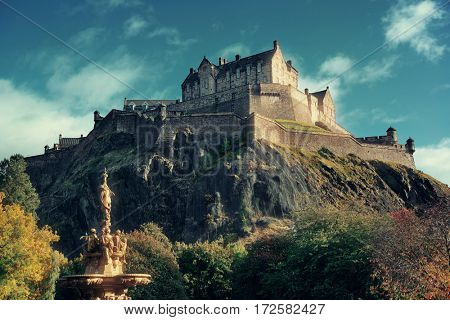 Edinburgh castle with fountain as the famous city landmark. United Kingdom.