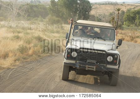 GALILEE ISRAEL - OCTOBER 24: SUV rides on the country road people travel on the jeep the off-road tour in Galilee Israel on October 24 2016