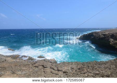 Aruba's east coast has crashing waves against lava rock.