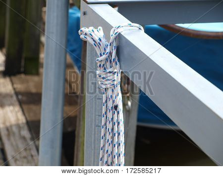 New marine rope hands at the ready on a slip cross bar.