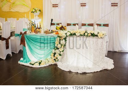 Decorated wedding table. Food on the table. Tableware. Empty glasses and wine glasses. Salad in a bowl.