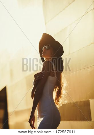 Stylish woman wearing big hat and glasses