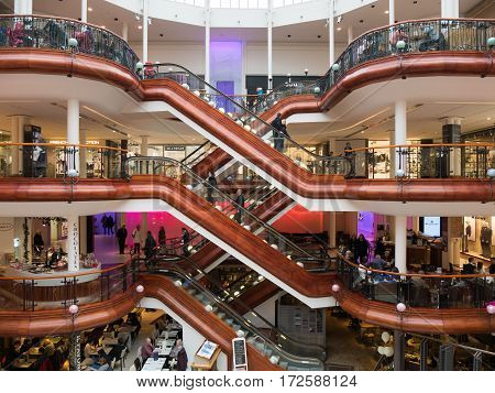 GLASGOW, SCOTLAND - 24 JAN 2017: Inside Princes Square shopping mall in Glasgow. The old building was redesigned and the interior is characterized by wooden stairs for which it has won design awards