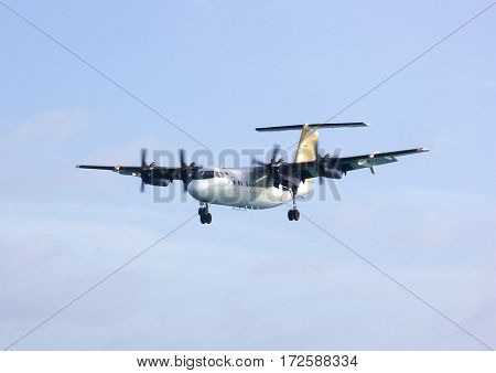 propeller airplane landing sky view.