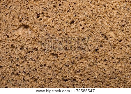 Brown bread, background texture. Macro shot. Stock image.