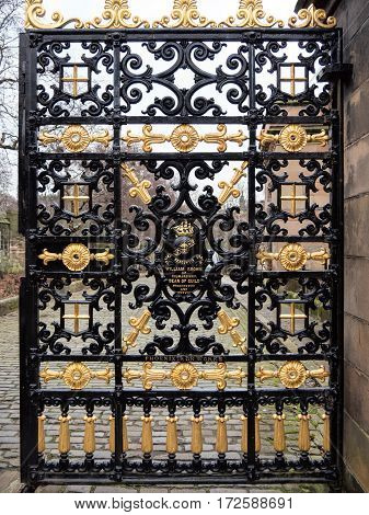 Ornate historic metal gate to Necropolis cemetery near Glasgow Cathedral dedicated to William Brown, dean of Guild in 1837