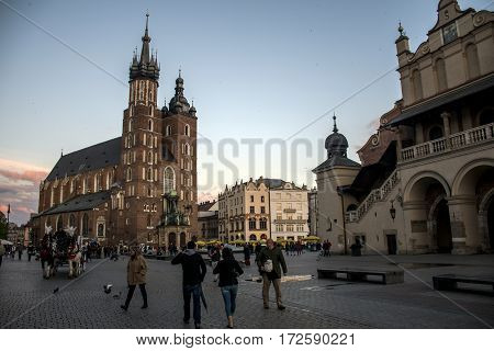 10.05.2015 Krakow Poland - Church of St. Mary and the Cloth Hall in the main Market Square in the city of Krakow in Poland