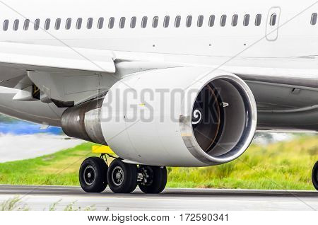 Aircraft engine on the runway before take-off at the airport