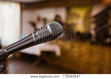 Microphone on the stand in the hall, enter an address, corporate